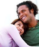 Happy man being hold by his girlfriend Royalty Free Stock Photos