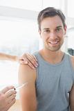 Happy man being injected by doctor Royalty Free Stock Photos