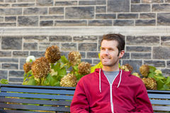 Happy Man on a Bench Stock Image