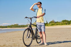 Happy man with bicycle on summer beach Royalty Free Stock Image