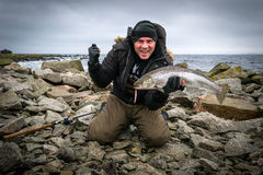 Happy man with big sea trout trophy Stock Images
