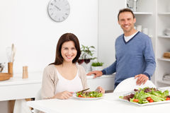 Happy man binging glasses of red wine to his wife Stock Photo
