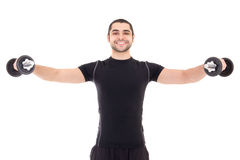 Happy man in black sportswear doing exercises with dumbbells iso Royalty Free Stock Photography