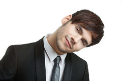 Happy man with a black suit and gray tie Royalty Free Stock Image