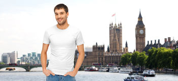 Happy man in blank white t-shirt over london city Stock Image