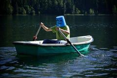 Happy man on the boat Stock Photos