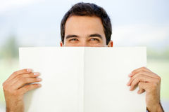 Happy man with book Stock Images