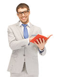 Happy man with book Royalty Free Stock Image