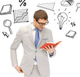 Happy man with book. Business and office concept - happy man with book royalty free stock image