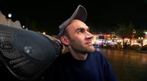 Happy man with boombox. On night street Stock Photo