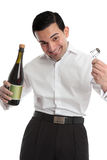 Happy man with bottle of champagne. A happy cheerful man or waiter celebrating holding uncorking a bottle of wine or champagne.  White background Stock Images