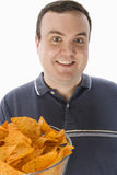 Happy Man With Bowl Of Nachos Royalty Free Stock Photography