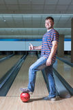 Happy man in bowling. With thumb up Royalty Free Stock Image