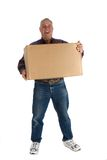 Happy man with a box. Delivery man or receiver holding large cardboard box Stock Photos