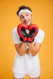 Happy man boxer in red gloves making heart by hands Stock Image