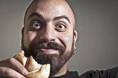 Happy man with bread in his mouth Stock Photos