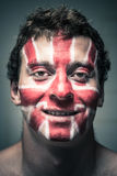 Happy man with British flag on face Royalty Free Stock Image