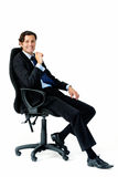 Happy man in business attire sitting down Royalty Free Stock Photos