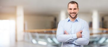 Man in the business center with crossed arms stock photos