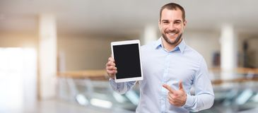 Man in the business center with tablet stock image