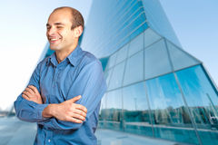 Happy man in a business district Royalty Free Stock Photo