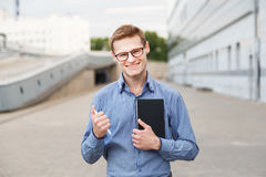 Happy man businessman with diary and pen in the hands Stock Images