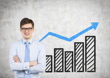 Happy man. Happy businessman and drawing profit on wall Stock Photography