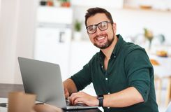 Happy man businessman, freelancer, student working at computer a. T home and office Stock Photos