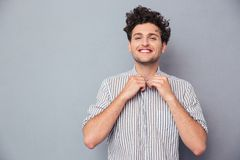 Happy man buttoning shirt Royalty Free Stock Photo