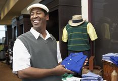 Happy Man Buying Shirt In Store Royalty Free Stock Images