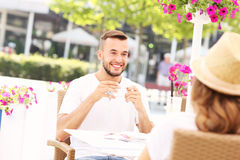 Happy man in a cafe Royalty Free Stock Photos