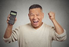 Happy man with calculator Stock Photos