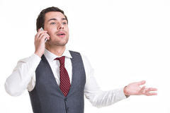 Happy man calling by mobile. Royalty Free Stock Image