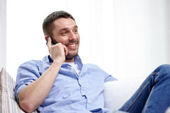 Happy man calling on smartphone at home Royalty Free Stock Photo