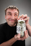 Happy man with canned money. Portrait of happy man with canned money stock photography