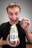 Happy man with canned money Royalty Free Stock Photography