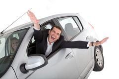 Happy man on a car Royalty Free Stock Photography