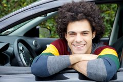 Happy man in car smiling looking camera Stock Photos