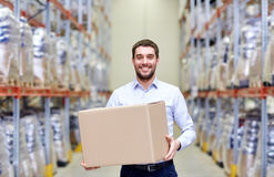 Happy man with cardboard parcel box at warehouse Royalty Free Stock Images