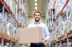Happy man with cardboard parcel box at warehouse Royalty Free Stock Photo