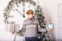 Happy man carries gifts Stock Photo