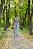 Happy man carrying basket of apples Stock Photos