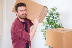 Happy man carrying boxes ready for home renovation Royalty Free Stock Image