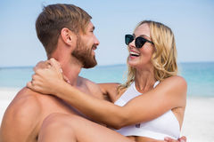 Happy man carrying girlfriend Royalty Free Stock Photo