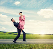Happy man carrying his wife Royalty Free Stock Photos
