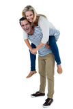 Happy man carrying woman piggyback Royalty Free Stock Images