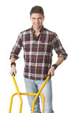 Happy man with cart used for transport Royalty Free Stock Photography