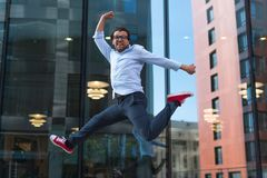 Happy man in casual wear jumping royalty free stock photos