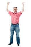 Happy man celebrating arms up success Stock Image