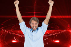 Happy man celebrating success with arms up Stock Photo